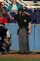 Home plate umpire Robert Porter during a game at Dwyer Stadium in Batavia, New York on June 29, 2010.  Photo By Mike Janes/Four Seam Images