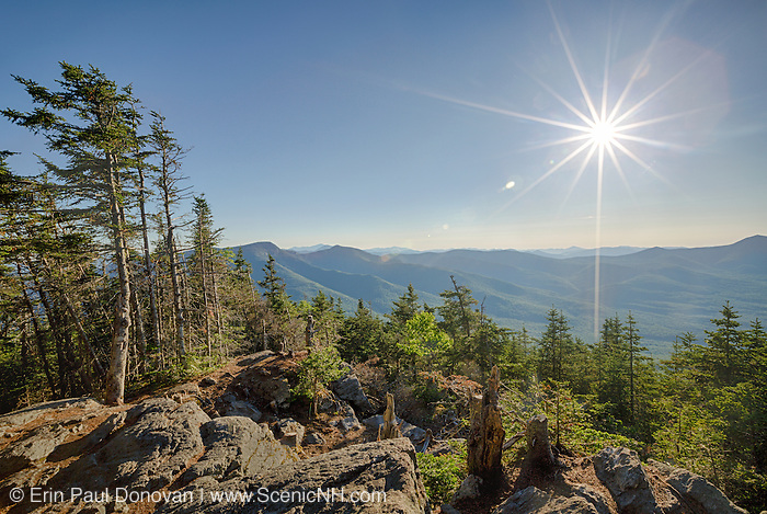 June 2014 - Mountain landscape from Mount Tecumseh in Waterville Valley, New Hampshire during the summer months. Vandals have improved the view of this summit by illegally cutting down trees. Forest Service has stated the cutting is unauthorized.