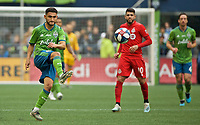 SEATTLE, WA - NOVEMBER 10: Seattle Sounders midfielder Cristian Roldan #7 passes the ball during a game between Toronto FC and Seattle Sounders FC at CenturyLink Field on November 10, 2019 in Seattle, Washington.