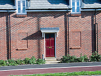 New development built with the windows bricked up.  Ashford, Kent.