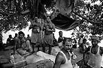 Laborers takes a recess from work at Burabazar in Kolkata, India