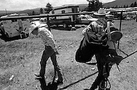 Cowboys leave the rodeo grounds after competition at the annual Lincoln Rodeo in Lincoln, MT in June 2006.  The Lincoln Rodeo is an open rodeo, which means competitors need not be a member of a professional rodeo association.