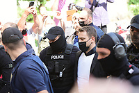Pictured: Charalambos (Babis) Anagnostopoulos being led to a magistrate guarded by police in Athens, Greece. Friday 18 June 2021<br />Re: Charalambos (Babis) Anagnostopoulos, the husband of Caroline Crouch, who was killed in front of her 11 month old daughter is due to appear before a Magistrate, charged with her murder at their home in Glyka Nera, near Athens, Greece.<br />The woman, 20, was allegedly first tortured and then strangled to death.