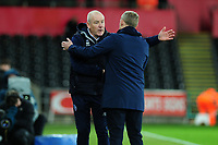 Mark Warburton Manager of Queens Park Rangers shakes hands with Steve Cooper Head Coach of Swansea City at full time during the Sky Bet Championship match between Swansea City and Queens Park Ranger at the Liberty Stadium in Swansea, Wales, UK. Tuesday 11 February 2020