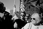 """Washington DC.District of Columbia.USA.January 27, 2007..US Actor Sean Penn watches behind the stage as he attends an anti-war demonstration on the National Mall in Washington DC. Tens of thousands massed to demand that Congress cut off funds for the Iraq war. He later addressed the crowd...Actor Sean Penn said lawmakers will pay a price in the 2008 elections if they do not take firmer action than to pass a nonbinding resolution against the war, the course Congress is now taking. """"If they don't stand up and make a resolution as binding as the death toll, we're not going to be behind those politicians,"""" he said. ...."""