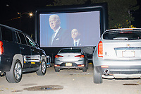 """Democratic nominee for President Joe Biden is seen on a screen as people gathered to watch the 2020 Democratic National Convention at a """"Ridin' with Biden"""" Drive-In Theater viewing event at Suffolk Downs in Boston, Massachusetts, on Wed., Aug. 19, 2020."""