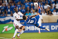 El Salvador forward Rodolfo Zelaya (11) attempts a bicycle kick as Trinidad and Tobago defender Daniel Cyrus (6) defends during a CONCACAF Gold Cup group B match at Red Bull Arena in Harrison, NJ, on July 8, 2013.