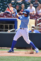 Omaha Storm Chasers Ramon Torres (17) swings during the Pacific Coast League game against the Nashville Sounds at Werner Park on June 5, 2016 in Omaha, Nebraska.  Omaha won 6-4.  (Dennis Hubbard/Four Seam Images)