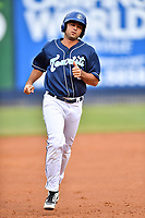 Asheville Tourists second baseman Coco Montes (5) rounds the bases after hitting a home run during a game against the Greenville Drive at McCormick Field on May 11, 2019 in Asheville, North Carolina. The Drive defeated the Tourists 9-8. (Tony Farlow/Four Seam Images)