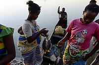 MADAGASCAR, village AMBOHITSARA at canal des Pangalanes, tribe ANTAMBAHOAKA, people buy fish/ MADAGASKAR, Mananjary, Dorf AMBOHITSARA am canal des Pangalanes,  Volksgruppe ANTAMBAHOAKA, Fischer verkaufen Fisch