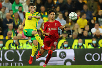 21st September 2021; Carrow Road, Norwich, England; EFL Cup Footballl Norwich City versus Liverpool; Billy Gilmour of Norwich City is under pressure from Kaide Gordon of Liverpool