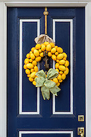 Decorative lemon wreath on a town house door, Alexandia, Virginia, USA