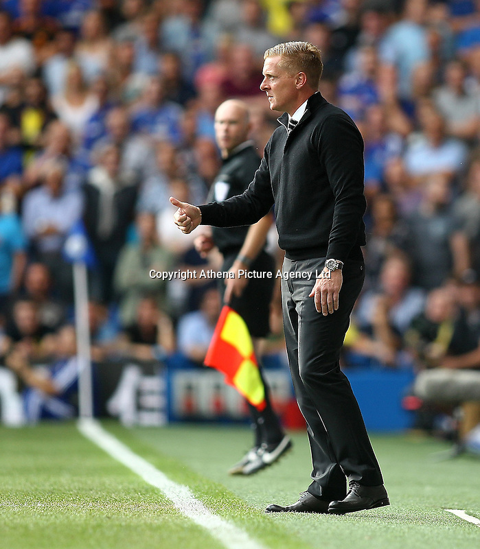 Garry Monk manager of Swansea looks pleased  during the Barclays Premier League match between  Chelsea and Swansea  played at Stamford Bridge, London