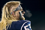 Nevada's Brock Hekking walks the sidelines during the second half of an NCAA college football game against Fresno State in Reno, Nev., on Saturday, Nov. 22, 2014. (AP Photo/Cathleen Allison)