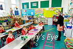 Derryquay NS students in the class room with their teacher Brid Nic Ghearilt.