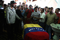 """Venezuelan boxer Edwin IncaValero, champion of the World-wide Council of Box (CMB), is mourning by relatives and friends in Merida, Venezuela, April 21st 2010.Valero, famed for an impressive record of 27 straight knockouts and a huge tattoo of Chavez on his chest, hanged himself in his jail cell last week. The boxer, who was nicknamed """"El Inca"""" in reference to an Indian warrior, committed suicide a day after he was arrested for murdering his 24-year-old wife."""