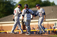 Mahoning Valley Scrappers manager Travis Fryman (10) takes the ball from pitcher Casey Shane (34) during a pitching change as catcher Li-Jen Chu (16) looks on during a game against the Batavia Muckdogs on July 3, 2015 at Dwyer Stadium in Batavia, New York.  Batavia defeated Mahoning Valley 7-4.  (Mike Janes/Four Seam Images)