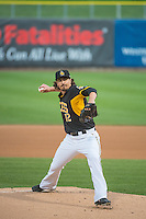 Zach Stewart (12) of the Salt Lake Bees delivers a pitch to the plate against the Tacoma Rainiers in Pacific Coast League action at Smith's Ballpark on May 7, 2015 in Salt Lake City, Utah.  (Stephen Smith/Four Seam Images)