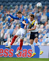 Ronan Curtis of Portsmouth and Sam Long of Oxford United compete for a header during Portsmouth vs Oxford United, Sky Bet EFL League 1 Play-Off Semi-Final Football at Fratton Park on 3rd July 2020
