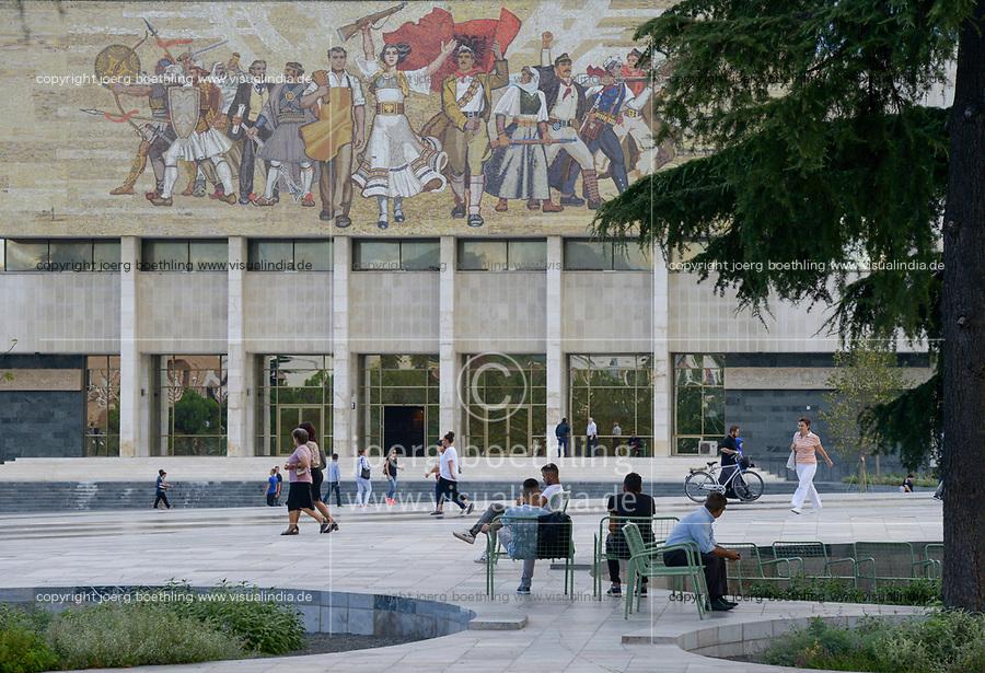 ALBANIA, Tirana, Palace of Culture  with large communist propaganda wall painting, built 1963 during Enver Hoxha communist rule / ALBANIEN, Tirana, Kulturpalast mit Wandgemaelde, gebaut 1963 waehrend der kommunistischen Herrschaft von Enver Hoxha, Rabatte mit Heilkraeuter Pflanzung
