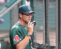 Pitching coach Kevin Walker (33) of the Greenville Drive makes a call to the bullpen during a game against the West Virginia Power May 2, 2010, at Fluor Field at the West End in Greenville, S.C. Photo by: Tom Priddy/Four Seam Images