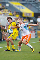 24 JULY 2010:  Guillermo Barros Schelotto of the Columbus Crew (7) and Andrew Hainault of the Houston Dynamo (31) during MLS soccer game between Houston Dynamo vs Columbus Crew at Crew Stadium in Columbus, Ohio on July 3, 2010. Columbus defeated the Dynamo 3-0.