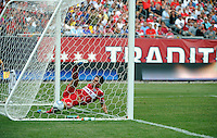 Chicago Fire defender Josip Mikulic (23) tries unsuccessfully to keep Wayne Rooney's chip from going into the Fire goal.  Manchester United defeated the Chicago Fire 3-1 at Soldier Field in Chicago, IL on July 23, 2011.