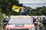 Tour Director Christian Prudhomme ASO waves the flag to start Stage 1 of the 2021 Tour de France, running 197.8km from Brest to Landerneau, France. 26th June 2021.  <br /> Picture: A.S.O./Pauline Ballet | Cyclefile<br /> <br /> All photos usage must carry mandatory copyright credit (© Cyclefile | A.S.O./Pauline Ballet)