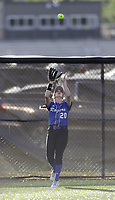 Rogers outfielder Ava Johnson (20) catches a flyball, Thursday, April 29, 2021 during a softball game at Bentonville High School in Bentonville. Check out nwaonline.com/210430Daily/ for today's photo gallery. <br /> (NWA Democrat-Gazette/Charlie Kaijo)