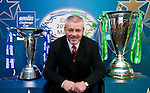 Warren Gatland with the Amlin challenge cup and Heineken cup  trophies. Both competitions finals will be held in Cardiff in2011