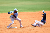 Tampa Bay Rays shortstop Alejandro Pie (64) throws to first base as Jose Dilone (56) slides in during a Minor League Spring Training game against the Atlanta Braves on June 1, 2021 at Charlotte Sports Park in Port Charlotte, Florida.  (Mike Janes/Four Seam Images)