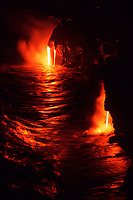 lava flowing into the ocean in the early morning hours, Hawaii, USA Volcanoes National Park, Big Island of Hawaii, USA, Pacific Ocean