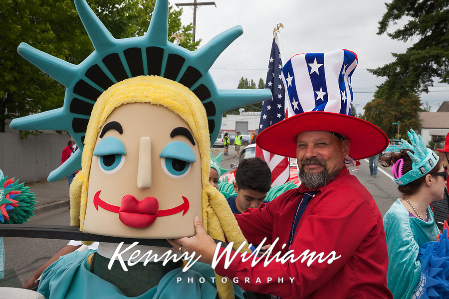 Man wearing large red, white and blue patriotic hat, Independence Day Parade 2016, Burien, Washington, USA.