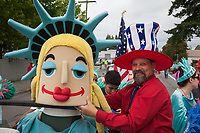 Man wearing large red, white and blue patriotic hat, Independence Day Parade 2016, Burien, Washington, USA.