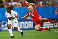USA's Meg Morris (L) and Chantal Fimian of Switzerland during the FIFA U20 Women's World Cup at the Rudolf Harbig Stadium in Dresden, Germany on July 17th, 2010.