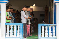 Borobudur, Java, Indonesia.  Muslims Praying at Friday Noon Prayers in a Neighborhood Mosque.