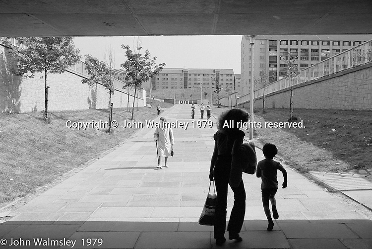 One of the wide walkways through the housing, Wester Hailes, Scotland, 1979.  John Walmsley was Photographer in Residence at the Education Centre for three weeks in 1979.  The Education Centre was, at the time, Scotland's largest purpose built community High School open all day every day for all ages from primary to adults.  The town of Wester Hailes, a few miles to the south west of Edinburgh, was built in the early 1970s mostly of blocks of flats and high rises.