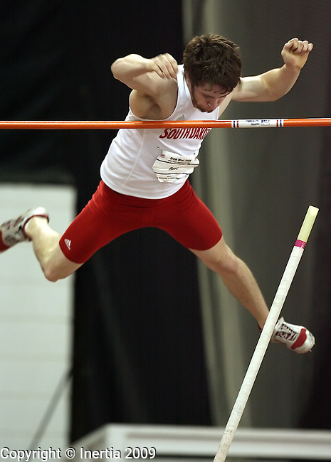 VERMILLION, SD - March 2:  Tim Rust of the University of South Dakota clears the bar during the pole vault of the Heptathlon at the Great West Indoor Track Meet Monday at the DakotaDome in Vermillion. (Photo by Dave Eggen/Inertia)