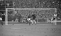 30.07.1966. Wembley Stadium, London England. 1966 World Cup final England versus Germany (4-2) After Extra time.  Wolfgang Weber ( GER) with a clearing header in front of Roger Hunt