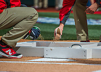 7 April 2016: Member of the Grounds Crew perfect the dirt and batting box lines at home plate prior to the Washington Nationals Home Opening Game against the Miami Marlins at Nationals Park in Washington, DC. The Marlins defeated the Nationals 6-4 in their first meeting of the 2016 MLB season. Mandatory Credit: Ed Wolfstein Photo *** RAW (NEF) Image File Available ***