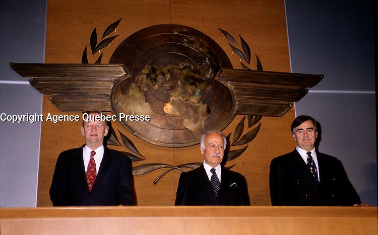 """Montreal (Qc) CANADA - File Photo - Dec 5th 1996 -<br /> Jean Chretien (L), ICAO President (L) and<br /> Lucien Bouchard,  Leader Parti Quebecois (from Jan 29, 1996 to March 2, 2001). seen in a May 1996 file photo at ICAO (OACI) New headquarter opening in Montreal.<br /> <br /> After the Yes side lost the 1995 referendum, Parizeau resigned as Quebec premier. Bouchard resigned his seat in Parliament in 1996, and became the leader of the Parti QuÈbÈcois and premier of Quebec.<br /> <br /> On the matter of sovereignty, while in office, he stated that no new referendum would be held, at least for the time being. A main concern of the Bouchard government, considered part of the necessary conditions gagnantes (""""winning conditions"""" for the feasibility of a new referendum on sovereignty), was economic recovery through the achievement of """"zero deficit"""". Long-term Keynesian policies resulting from the """"Quebec model"""", developed by both PQ governments in the past and the previous Liberal government had left a substantial deficit in the provincial budget.<br /> <br /> Bouchard retired from politics in 2001, and was replaced as Quebec premier by Bernard Landry."""