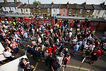 Home supporters gathering behind the Braemar Road stand before Brentford hosted Leeds United in an EFL Championship match at Griffin Park. Formed in 1889, Brentford have played their home games at Griffin Park since 1904, but are moving to a new purpose-built stadium nearby. The home team won this match by 2-0 watched by a crowd of 11,580.
