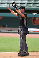 Umpire Chase Eubanks calls time during a game between the FCL Pirates Gold and FCL Orioles Orange on August 9, 2021 at Ed Smith Stadium in Sarasota, Florida.  (Mike Janes/Four Seam Images)