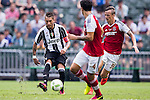Juventus' player Roberto Pereyra contests the ball against South China's player Griffiths Ryan Alan during the South China vs Juventus match of the AET International Challenge Cup on 30 July 2016 at Hong Kong Stadium, in Hong Kong, China.  Photo by Marcio Machado / Power Sport Images