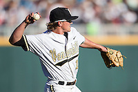 Vanderbilt Commodores pitcher Carson Fulmer (15) warms up before Game 12 of the NCAA College World Series against the TCU Horned Frogs in on June 19, 2015 at TD Ameritrade Park in Omaha, Nebraska. The Commodores defeated TCU 7-1. (Andrew Woolley/Four Seam Images)