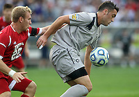 HOOVER, AL - DECEMBER 09, 2012: Caleb Konstanski (22) of Indiana University comes up behind Brandon Allen (10) of Georgetown University during the NCAA 2012 Men's College Cup championship, at Regions Park, in Hoover , AL, on Sunday, December 09, 2012.