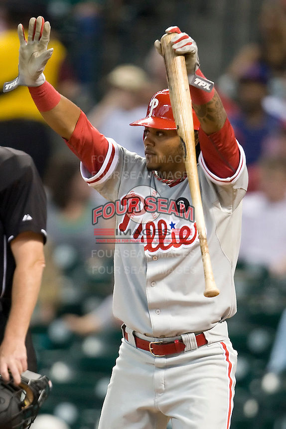Philadelphia Phillies third baseman Michael Martinez #19 signals the oncoming baserunner during the Major League Baseball game against the Houston Astros at Minute Maid Park in Houston, Texas on September 12, 2011. Houston defeated Philadelphia 5-1.  (Andrew Woolley/Four Seam Images)