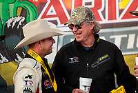 Feb 23, 2020; Chandler, Arizona, USA; NHRA top fuel driver Steve Torrence celebrates with crew chief Richard Hogan after winning the Arizona Nationals at Wild Horse Pass Motorsports Park. Mandatory Credit: Mark J. Rebilas-USA TODAY Sports