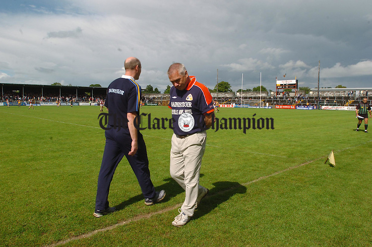 A troubled looking Westmeath manager Paudie O Shea and his counterpart for Clare John Kennedy pass each other on the side line in Cusack park as the big game draws to a conclusion. Photograph by John Kelly.