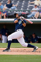 Javier Colina #11 of the Charlotte Knights follows through on his swing against the Columbus Clippers at Knights Stadium May 25, 2010, in Fort Mill, South Carolina.  Photo by Brian Westerholt / Four Seam Images